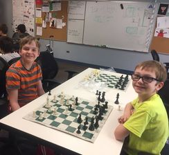 Students practicing their chess game